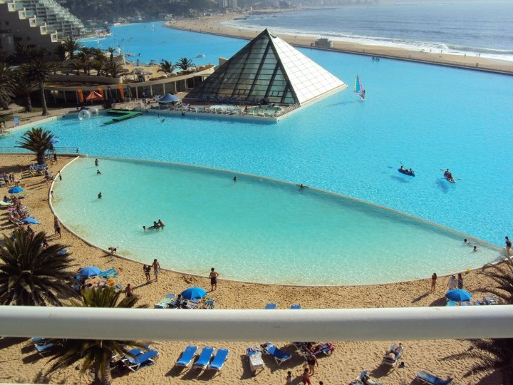 Top 10 most beautiful swimming pools to visit in the summer worldwide sunglasses and style for San alfonso del mar swimming pool